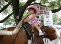 Graciela riding a Longhorn